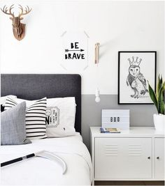 Half painted wall in grey in grey and white boys room