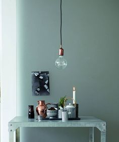 A stylish and modern hanging light with an industrial touch.Black and white cable or black only cableSimple and right on trend with its copper tone finish, the <strong>Kant pendant light</strong> is perfect to hang over a kitchen counter, a vintage wooden table or in a hallway. The <strong>Kant pendant light</strong> comes with a 3m B&W fabric cable. <strong>Note to customers:</strong> Please note that the large bulb featured on the photo is not supplied.Fabric wire and copper tone metal ...