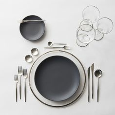 Platinum Halo Glass Charger + Heath Ceramics in Slate/Indigo + Moon Flatware in Polished Steel + Silver Salt Cellars + Chloe Platinum Rimmed Stemware | Casa de Perrin Design Presentation