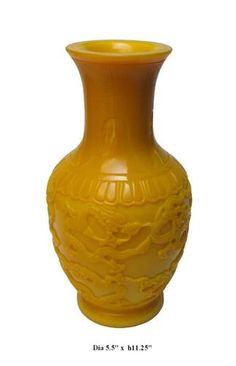 Peking glasses are made at a extremely high temperature (over 1000℃), that's why it has higher density and more beautiful color than regular glass.    This imperial yellow vase is made of Peking glass and has dragon hand carving instead of traditional hand painting. It is one of the kind art works and worth of being collected.