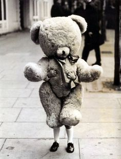 Child holding a teddy bear in London, 1968