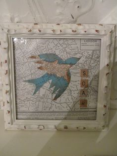 love this idea of old maps and scrabble tiles