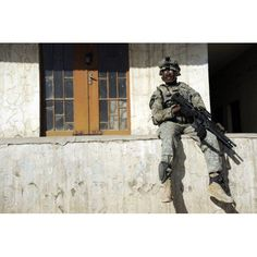 US Army soldier visiting an Iraqi National Police combat outpost in Mosul Iraq Canvas Art - Stocktrek Images (34 x 23)