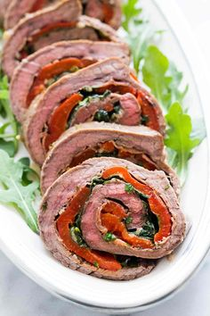 Butterflied flank steak that is marinated, rolled up with prosciutto, basil, Parmesan, and roasted bell peppers, and then roasted in the oven. Great for a party.
