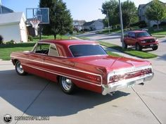 64' Chevy Impala.. This one looks just like one of my dad's Impalas.  Every Cholo in Van Nuys wanted to buy it from my dad.  He'd go to Wash World and get mobbed.  Great to drive.  I miss that car.