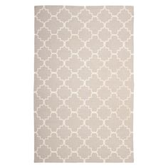 Create an eye-catching focal point in your foyer or anchor your living room seating group with this flatweave wool rug, showcasing a chic quatrefoil motif.  ...