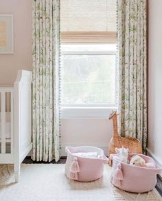 White and green floral pom pom curtains layered over cream Roman shades in a girls nursery adding a sophisticated touch against blush pink walls. Pink And Green Nursery, White Nursery, Baby Nursery Decor, Baby Bedroom, Nursery Room, Girl Nursery, Girls Bedroom, Nursery Design, Bedrooms