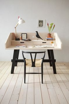 I like the overall aesthetic of this desk: Black, White, & Chunky. The draws are clearly too low (the desk's contents will prevent them from opening) and I am unsure if the leg's horizontal support will get in the way of long legged humans.
