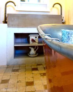 A fabulous copper and tin bateau bath and bespoke sandstone sink in the master ensuite of the luxury rental farmhouse, Villa Tropez. Natural Stone Flooring, Open Plan Living, Provence, Bespoke, Tin, Villa, Copper, Farmhouse, Bath