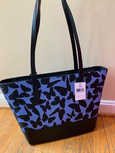 """COLOR: blue multi Size: large 10.5""""H x 11.5""""L (Bottom) 16""""L (top) x 4.5""""D 11:5"""" handle drop Removable and reversible butterfly Top zip closure Smooth leather Interior: black lining. 1 zipper pocket and 2 slips pockets Kate Spade Totes, Kate Spade Tote Bag, Tote Handbags, Tote Bags, Butterfly Top, Leather Interior, Smooth Leather, Color Blue, Slip On"""