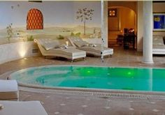 In 1999, the world's first _vinothérapie_ spa opened at the Château Smith Haut Lafitte vineyards near Bordeaux. This was followed in 2003 by the Caudalie Spa at the 5-star Relias San Maurizio in Italy's Piedmont region, a 17th century monastery spectacularly situated among the famous vineyards of the Langhe.       Spa at Relais Il Falconiere  These treatments are especially popular in areas where there are many wineries because spa-goers already tend to be in a wine-friendly frame of mind…