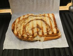 Parchment paper in panini maker. No clean up and still get grill marks