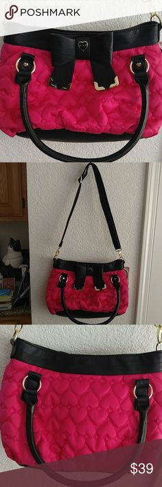 Betsey Johnson hot pink black bow bag This is a brand new hot pink bag with hearts quilted all over it. It has a shoulder strap that is removable.Never been used. It measures 15 inches wide and 9 inches tall. Betsey Johnson Bags Shoulder Bags
