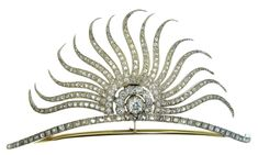 Victorian Tiara c1890 | The central motif in the shape of a sunburst. Diamond & silver over gold tiara, with one old mine cut diamond weighing 0.95 cts 23 old mine cut diamonds weighing 2.70 cts & 237 rose cut diamonds weighing 3.45 cts. Total weight 7.10 cts.