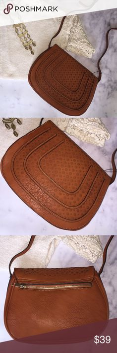 """NWT Perforated Detail Saddle Bag cognac colored new with tags perforated detail saddle bag with adjustable strap. 11"""" W x 8.5""""H. 54"""" strap when fully extended. magnetic and zip closure with backside zip pocket, interior side zip pocket and side open pocket. manmade faux leather with grained texture and slightly aged look.? Bags"""