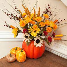 I'm SO gonna try this Dollar Tree idea! Styrofoam pumpkin with fall flowers.