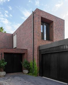 These three brick buildings, featuring deep-set windows and internal courtyards, have been arranged by B.E. Architecture around a cobbled lane in the Australian town of Windsor.
