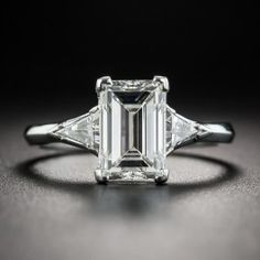 We call this sleekly modeled diamond an emerald-cut, although technically, due to the uncut (unbeveled) corners, some, including the GIA, refer to it as a rectangular step-cut diamond. In either case, and besides the fact that 'they don't make 'em like this anymore', there's no disputing the classic beauty of this distinctively dazzling mid-century vintage jewel.