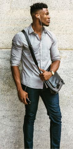 Men's Spring fashion street style 2017. Casual look featuring dress shirt, jeans, bag, and dress watch.