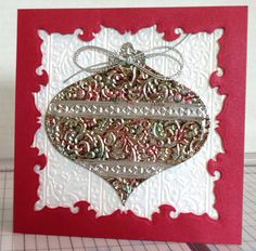 Gorgeous! from SCS Poster jodylb  the ornament is four layers of aluminum foil - cheap heavy duty - that I ran through an embossing folder and pounced with various red and green shades of alcohol ink. This was die cut, then I used a q-tip dipped in alcohol to clean the ink off the stripes and cap.  Background is white shimmer paper embossed with the same folder, the stripes run vertically.