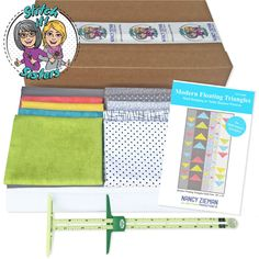 """Our Exclusive Modern Floating Triangles Quilting Bundle Boxes include everything you'll need! Make a quick column quilt with crosswise fabric strips and dimensional folded triangles 🔼 made from fabric squares! This is an easy piecing project – even for beginners! The 20"""" x 34"""" quilt size is ideal for display on a wall or table–you decide! Now up to 24% Off through Jan. 19 at ShopNZP.com #NZPBlog #StitchitSisters #ModernFloatingTrianglesQuilt #NZPTeam #NancyZiemanProductions #ShopNZP Triangle Wall, Triangle Pattern, Fabric Strips, Fabric Squares, Triangle Quilt Tutorials, Prairie Points, Sewing With Nancy, Nancy Zieman, Table Runner Pattern"""