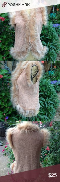 "Vest This sweater vest is gorgeous! Lined with a beautiful pink/ peach shade of faux fur. Lots of stretch and feels great on. New condition. Measures 23"" length and 21"" across the chest. Three hook and eye closures. Lisa International Jackets & Coats Vests"