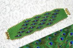 Peacock beaded wave bracelet (ndebele technique) by valerval on Zibbet