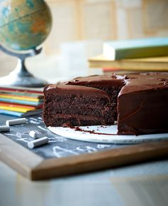 Indulge in a slice of cake inspired by Roald Dahl's book Matilda. The rich chocolate cake recipe is made with three layers of sponge and a creamy chocolate icing.