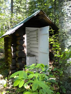 Alaskan outhouse. Amasing contrast. Anyone can see why I want to paint the inside of our cabin.