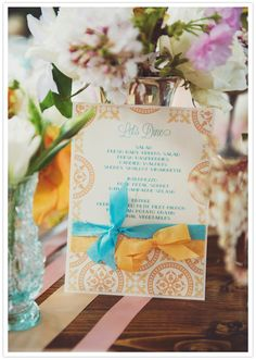 orange and blue printed menus  Dress: Calla by Love, Yu  Fashion & Styling: Everthine Bridal Boutique  Photography: Michelle Gardella  Florals: Petal Floral Design  Invites: Posh Paperie  Venue: Pine Orchard Club