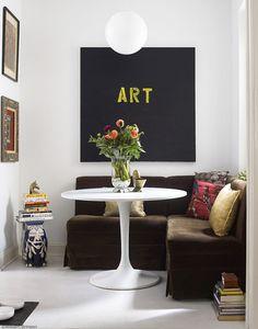alucino con la mesa tulip y las lámparas  bola, el cuadro, lo quiero ya!!!