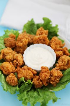 Crispy Buttermilk Popcorn Chicken - Super easy, crispy popcorn chicken made with few ingredients! Serve at parties or for weeknight meals with hot sauce, honey or Ranch dressing. Thecomfortofcooking.com