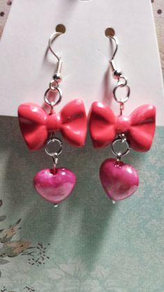 These+adorable+earrings+are+handmade+by+me.+They+feature+pink+bows+and+matching+pink+heart+beads. $6