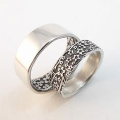 Handmade Opposites Attract wedding band set in Cherry Blossom pattern. Sterling silver rings by Chuck Domitrovich of Down to the Wire Designs.
