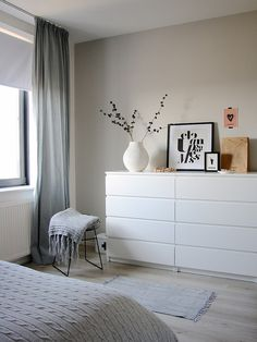 Two four-drawer Malm dressers side-by-side