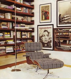 this is kind of bachelor pad-y, but i still dig the plaid eames chair.