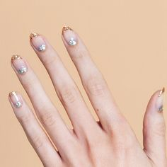 From a glittery french manicure to slime green nail art here are 15 New Year's Eve nails ideas that will help you ring in 2020.