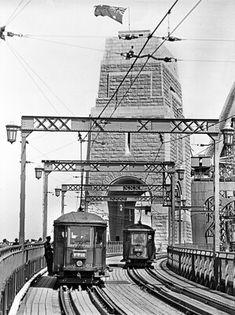 Trams cross the Sydney Harbour Bridge in 🌹 Harbor Bridge, Sydney Harbour Bridge, Great Photos, Old Photos, The Rocks Sydney, Australian Road Trip, Country Home Exteriors, Plane Photos, Light Rail