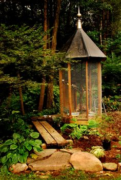 very pretty garden aviary... though useless if you actually want your bird to be able to use most of the enclosed space.  A bird big enough for the central perch probably isn't going to fly in this vertical cage.  :/