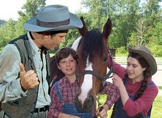 Justin is giving Andi and Levi a few words before they take off on a horseback ride.