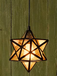 Fitted with an adapter to convert a can light, this small 12-point star pendant would look good hung in multiples.   Find it @homedepot