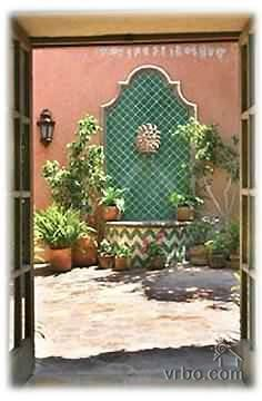 Spanish style homes with courtyards beverly hills duplex for Spanish style fountains for sale