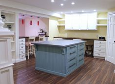I LOVE THIS.  The shelves on the sides of the wall cabinets are a great idea!  And, she even gives directions for building the center island.  Great idea to put a center island with a bar extension.