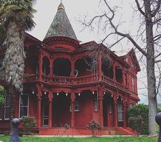 Gothic Victorian mansion. Painting a Queen Anne in one color obscures the details, whether it is white or red. Colors don't have to be bright to enhance the architecture. Buildings