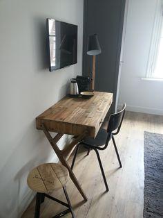 Wooden desk at Eye Hotel