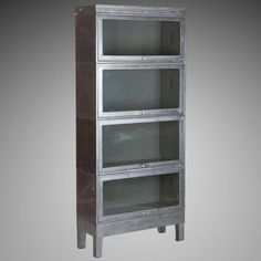 Industrial Metal Stacking Glass Front Barrister Bookcase - World War II era stacking metal bookcase has a footed base, top piece and four glass front ...
