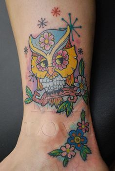 Cute Owl Tattoo.... not the owl for me, but I like the flowers below.
