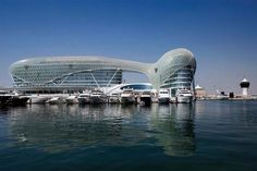 Yas Viceroy. A true architectural triumph, this five star iconic hotel is the only one in the world to straddle an F1 race track being breathtakingly built half on land and half over water. The hotel's main feature is its unique 'grid shell' - a 219 metre expanse of sweeping curvilinear glass and steel covering that drapes over the two hotel towers, linked by a bridge. Website: viceroyhotelsandresorts.com/abudhabi