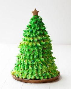 A little bit of carving, a simple star piping tip, and a handful of magic brings this Red Velvet Christmas Tree Cake cake to life in time for the holidays! Christmas Tree Cake, Xmas Tree, Christmas Cookies, Christmas Eve, Winter Holiday, Watercolor Cake Tutorial, Food Styling, Gold Luster Dust, Cake In A Cone