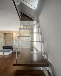 Elisabete Saldanha combines historical features with contemporary details at House in Guimarães